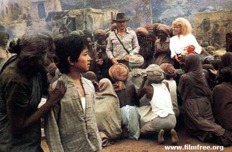 ইন্ডিয়ানা জোন্স অ্যান্ড দ্য টেম্পল অব ডোম । অন্ধবিশ্বাসী হাড় জিরজিরে গরীব লোকগুলো একজন অবতারের জন্য অপেক্ষা করছে